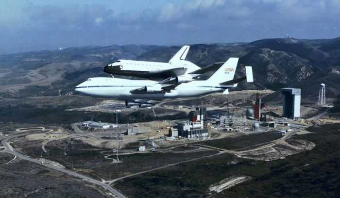 The space shuttle being transported to Vandenberg Air Force Base